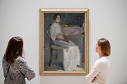 "© Licensed to London News Pictures. 17/07/2019. LONDON, UK. Staff members view ""Costume picture II, 1909, by Helene Schjerfbeck at the preview of the first solo UK exhibition of Finnish artist Helene Schjerfbeck at the Royal Academy of Arts in Piccadilly.  The exhibition features around 65 portraits, landscapes and still lifes and runs 20 July to 27 October 2019.  Photo credit: Stephen Chung/LNP"