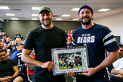 Joe Latta thanks Nick Haining as the Bristol Bears squad gather to make presentations to departing players after the Bristol Bears Team Run ahead of the Sale Sharks Game - Rogan/JMP - 02/05/2019 - RUGBY UNION - Ashton Gate Stadium - Bristol, England - Bristol Bears v Sale Sharks - Gallagher Premiership Rugby.