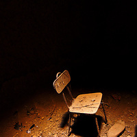 Chair at abandoned underground cellar where the roof collapsed.
