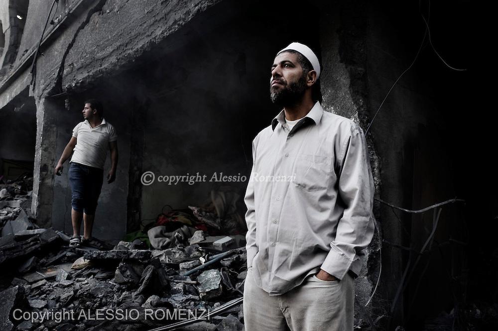Gaza City: Palestinians are seen on the site of an Israeli air strike in Gaza City. November 18, 2012. ALESSIO ROMENZI