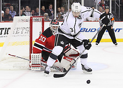 Oct 13; Newark, NJ, USA; Los Angeles Kings right wing Dustin Brown (23) looks to tip the puck past New Jersey Devils goalie Martin Brodeur (30) during the first period at the Prudential Center.