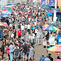 Hundreds of  people walk on the Santa Monica on Friday, April 1, 2011.