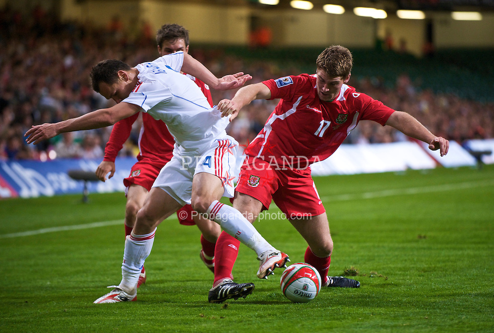 CARDIFF, WALES - Wednesday, September 9, 2009: Wales' Sergei Ignahevich and Russia's Sam Vokes during the FIFA World Cup Qualifying Group 3 match at the Millennium Stadium. (Photo by David Rawcliffe/Propaganda)