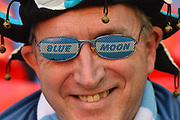 A Manchester City fan wearing Blue Moon shades before the Carabao Cup Final match between Chelsea and Manchester City at Wembley Stadium, London, England on 24 February 2019.