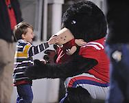 A fan greets Rebel the Bear mascot at Ole Miss vs. Louisiana Tech in Oxford, Miss. on Saturday, November 12, 2011.