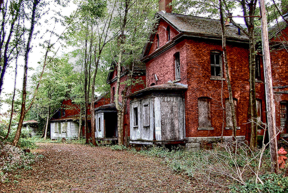 Looking up at the abandoned Officers quarters of the deserted Fort Andrews Army Base on Peddocks Island in Boston Harbor.