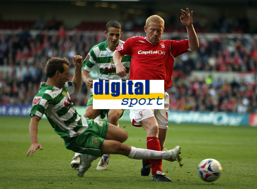 Photo: Rich Eaton.<br /> <br /> Nottingham Forest v Yeovil Town. Coca Cola League 1. Play off Semi Final 2nd Leg. 18/05/2007. Yeovils Marcus Stewart tackles Forests Gary Holt