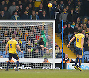 Oxford Utd keeper Ryan Clarke tips ball over the bar during the Sky Bet League 2 match between Portsmouth and Oxford United at Fratton Park, Portsmouth, England on 28 February 2015. Photo by Mark Davies.