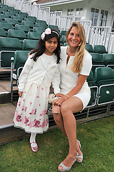 Left to right, MISS MARYAM AL HABTOOR and tennis player SANTA SUSHINSKA at Al Habtoor Royal Windsor Cup Final 2012 at Guards Polo Club, Berkshire on 24th June 2012.