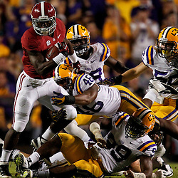 November 3, 2012; Baton Rouge, LA, USA; Alabama Crimson Tide running back T.J. Yeldon (4) breaks a tackle by LSU Tigers linebacker Kevin Minter (46) during the second quarter of a game at Tiger Stadium.  Mandatory Credit: Derick E. Hingle-US PRESSWIRE