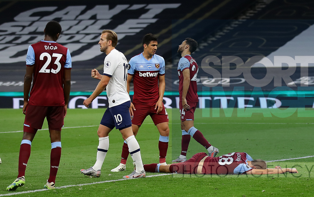 Tomas Soucek of West Ham United lies bereft after scoring an own goal during the Premier League match at the Tottenham Hotspur Stadium, London. Picture date: 23rd June 2020. Picture credit should read: David Klein/Sportimage