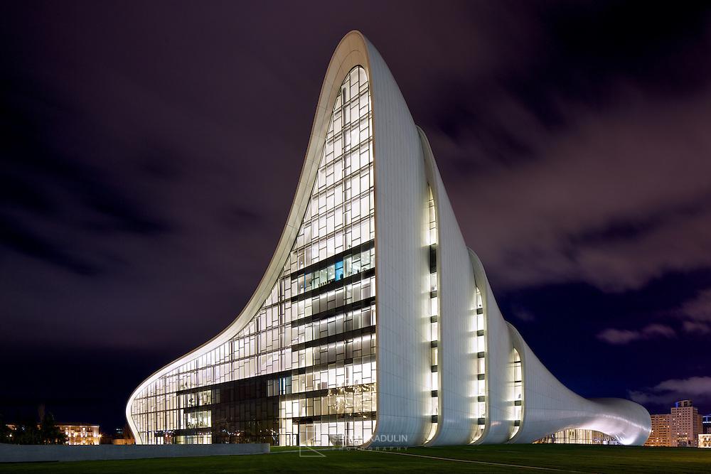 Futuristic forms of modern architecture. Heydar Aliyev Cultural Center in Baku, Azerbaijan. Evening view. Building by Zaha Hadid architects.