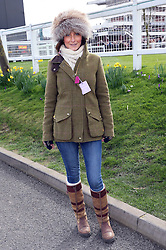 Race-goer  Sarah Robinson arriving at the opening day of the Cheltenham Festival, United Kingdom, Tuesday, 11th March 2014. Picture by Stephen Lock / i-Images