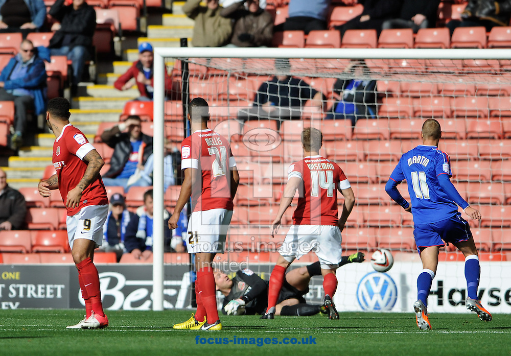 Picture by Richard Land/Focus Images Ltd +44 7713 507003.29/09/2012.Aaron Cresswell of Ipswich Town free kick sneaks under Ben Alnwick during the npower Championship match at Oakwell, Barnsley.