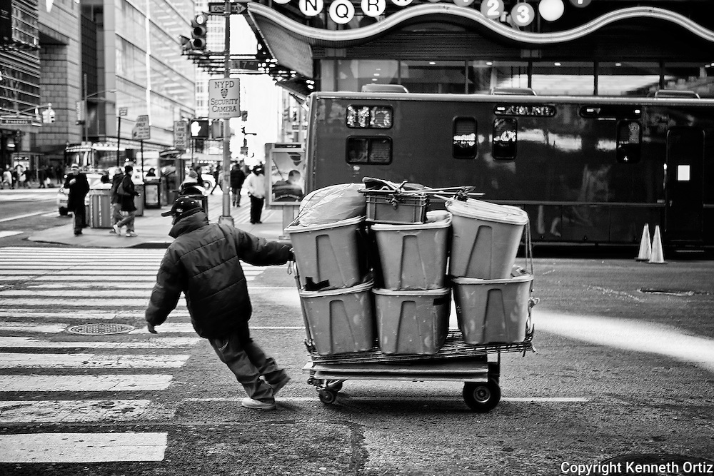 A Street Vendor hauling his goods up 7th Avenue in Time Square, New York City.