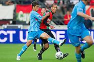 27-08-2011: Voetbal:NEC Nijmegen:Heracles Almelo:Niijmegen<br /> NEC's Ryan KOOLWIJK in duel met Heracles Almelo's EVERTON <br /> Foto: Geert van Erven