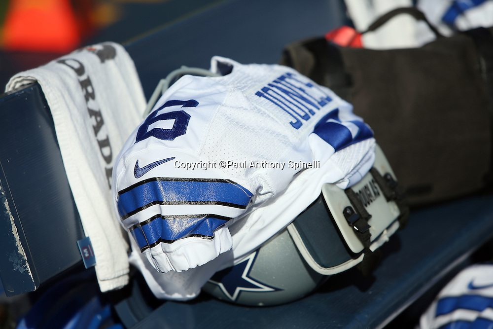 A Dallas Cowboys jersey and shoulder pads lie on the bench before the 2015 NFL preseason football game against the San Diego Chargers on Thursday, Aug. 13, 2015 in San Diego. The Chargers won the game 17-7. (©Paul Anthony Spinelli)