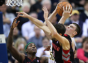 April 09, 2012; Indianapolis, IN, USA; Indiana Pacers power forward Tyler Hansbrough (50) brings down a rebound against Toronto Raptors power forward Ed Davis (32) and Toronto Raptors point guard Jose Calderon (8) at Bankers Life Fieldhouse. Indiana defeated Toronto 103-98. Mandatory credit: Michael Hickey-US PRESSWIRE