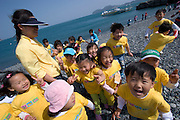 Geojedo (Geoje Island), Hallyeo Maritime National Park. Groups of school kids at Hakdongmongdol pebble beach.