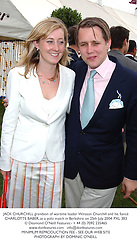 JACK CHURCHILL grandson of wartime leader Winston Churchill and his fiancé CHARLOTTE BABER, at a polo match in Berkshire on 25th July 2004.PXL 383
