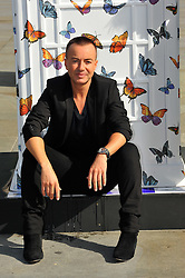 Fashion designer Julien Macdonald  with red K6 telephone boxes transformed into a variety of designs on display in Trafalgar Square in London, Friday, 15th June 2012. The ArtBox project was launched by British Telecom to mark 25 years of the charity ChildLine.  Photo by: Chris Joseph / i-Images