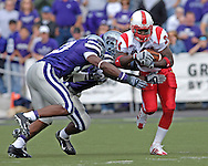 Louisville running back George Stripling (24) rushes up field against pressure from Kansas State defenders at Bill Snyder Family Stadium in Manhattan, Kansas, September 23, 2006.  The 8th ranked Louisville Cardinals beat K-State 24-6.