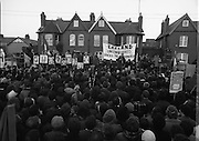 "H-Block Hunger-Strike Protest.   (M54)..1980..06.12.1980..12.06.1980..6th December 1980..In support of the prisioners on hunger strike in Northern Ireland a protest march was organised in Dublin. The march was to highlight the treatment of prisioners who wer on hunger strike and on the ""blanket"" protest. Part of the prisioner demand was that they be treated as political prisioners and not as criminals or terrorists..Image of the platform set up on Merrion Road, Dublin. An tAthair Piaras ÓDúill is seen addressing the crowd."