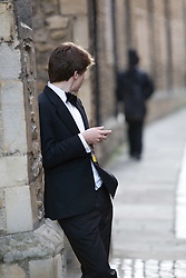 ©Licensed to London News Pictures. 19/06/2012. Cambridge, UK. Students make their way home in the morning after the The First and Third Trinity Boat Club May Ball at Trinity College, Cambridge. At the end of each academic year in June, many of the colleges at Cambridge University hold a May Ball with a strict black-tie dress code. Photo credit : Michael Derringer/LNP