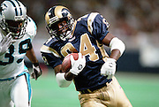 Running back Trung Canidate (24) of the St. Louis Rams runs past Defensive Back Damien Richardson (39) of the Carolina Panthers during a 48 to 14 win by the Rams on 11/11/2001..©Wesley Hitt/NFL Photos