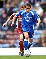 Photo: Paul Greenwood.<br />Burnley FC v Cardiff City. Coca Cola Championship. 09/04/2007.<br />Cardiff's Michael Chopra (R) gets the better of Wade Elliott