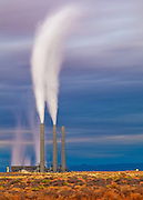 One smokestack gets the day off as dense white steam flows into the atmosphere at the Navajo Generating Station near Page, Arizona