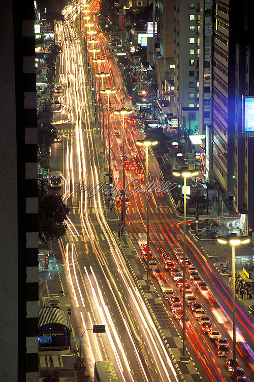 Paulista avenue at night, the most famous business address in this mega-city. Streaking lights of cars and buses for as far as the eye can see.   Sao Paulo, BRAZIL ..