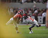 Alabama wide receiver Julio Jones (8) is tackled by Ole Miss safety Fon Ingram (35) at Bryant-Denny Stadium in Tuscaloosa, Ala.  on Saturday, October 16, 2010. Alabama won 23-10.