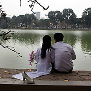 A couple celebrate their wedding beside Hoan Kiem Lake, Hanoi, Vietnam, Hanoi is the capital of Vietnam and the country's second largest city. Hanoi, Vietnam. 17th March 2012. Photo Tim Clayton