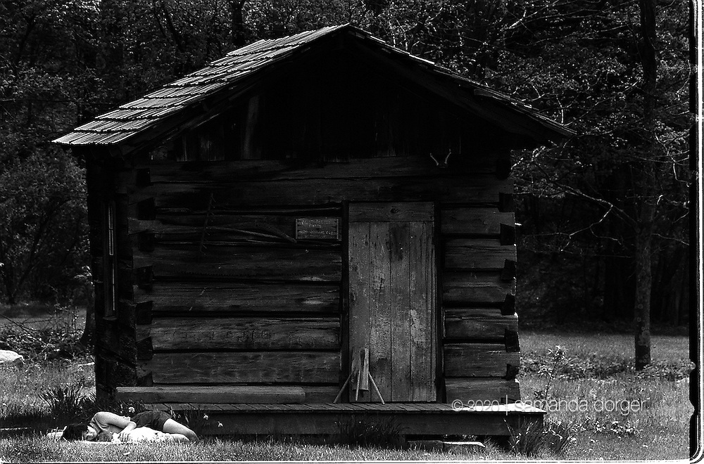 An original cabin built by settlers in the 1800s sits in the meadow in Helvetia, West Virginia.