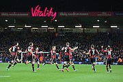 Bournemouth players celebrate the opening goal during  the Barclays Premier League match between Bournemouth and Manchester United at the Goldsands Stadium, Bournemouth, England on 12 December 2015. Photo by Phil Duncan.