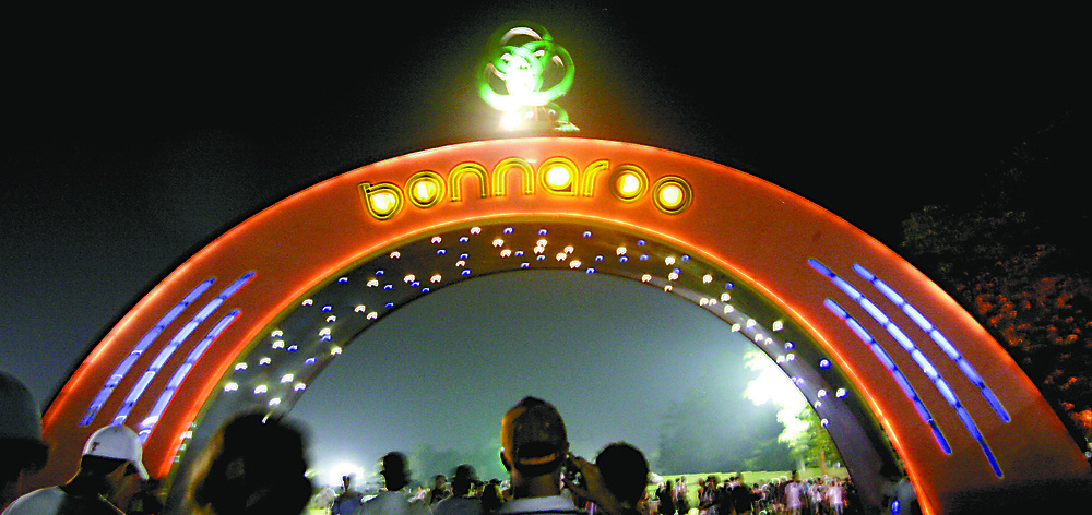 Fans stroll under the signature Bonnaroo arch Thursday night on their way into Centeroo, the main activity area of the festival at last year's Bonnaroo.