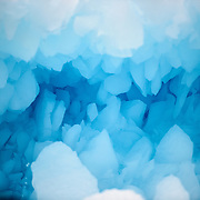 Jagged crystals of blue ice in a crevasse in an iceberg in Hughes Bay in Antarctica.