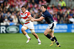 Matt Scott of Scotland passes the ball - Mandatory byline: Patrick Khachfe/JMP - 07966 386802 - 23/09/2015 - RUGBY UNION - Kingsholm Stadium - Gloucester, England - Scotland v Japan - Rugby World Cup 2015 Pool B.