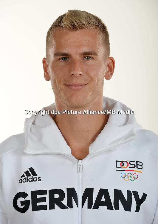 Jan Vandrey poses at a photocall during the preparations for the Olympic Games in Rio at the Emmich Cambrai Barracks in Hanover, Germany. July 25, 2016. Photo credit: Frank May/ picture alliance. | usage worldwide