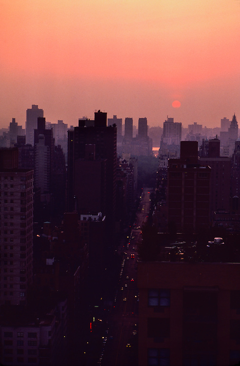 New York City at sunset, uptown, from roof of building