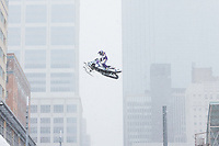 Minneapolis, MN - Feb 3, 2018: Polaris UpsideDowntown with daredevil snowmobiler Levi LaVallee doing stunts and a backflip over Nicollet Mall in Minneapolis, part of the festivities leading up to Super Bowl LII between the New England Patriots and Philadelphia Eagles.
