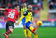Exeter City's Jordan Tillson and Dagenham & Redbridge's Ashley Chambers during the Sky Bet League 2 match between Exeter City and Dagenham and Redbridge at St James' Park, Exeter, England on 2 January 2016. Photo by Graham Hunt.