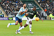 Freddie Ladapo (19) of Plymouth Argyle is held by Michael Ihiekwe (4) of Accrington Stanley during the EFL Sky Bet League 1 match between Plymouth Argyle and Accrington Stanley at Home Park, Plymouth, England on 22 December 2018.