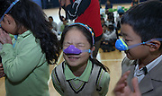SHANGHAI, CHINA - NOVEMBER 07: (CHINA OUT) <br /> <br /> School hands Out Nasal Mask to fight Against Smog To Students In Shanghai<br /> <br /> Students wearing nasal masks play at playground in Pinghe Bilingual School on November 7, 2014 in Shanghai, China. Shanghai Pinghe Bilingual School gave out nasal masks against smog to some of their students and organized lectures of how to prevent smog to protect children's health due to the heavy smog in Shanghai. It was just an experiment and if the result turned positive, all students will follow in school. <br /> ©Exclusivepix