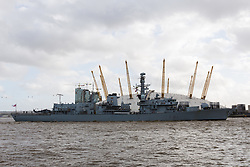 © Licensed to London News Pictures. 21/10/2017. LONDON, UK.  HMS Sutherland, a Type 23 frigate of the British Royal Navy travels on the River Thames passing the O2, approaching West India Dock, Canary Wharf for Trafalgar Day celebrations. The ship is celebrating the 20th anniversary of her commissioning this year and will be visited by Her Majesty the Queen next week..  Photo credit: Vickie Flores/LNP