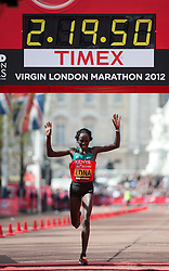 © London News Pictures. 22/04/2012. London, UK. Edna Kiplagat of Kenya crosses the finnish line to come second in the women's elite race at  the 2012 Virgin London Marathon in London on April 22, 2012. Photo credit : Ben Cawthra /LNP