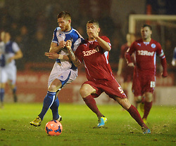Bristol Rovers' Matt Harrold and Crawley Town's Kyle McFadzean challenge for the ball - Photo mandatory by-line: Seb Daly/JMP - Tel: Mobile: 07966 386802 18/12/2013 - SPORT - FOOTBALL - Broadfield Stadium - Crawley - Crawley Town v Bristol Rovers - FA Cup - Replay