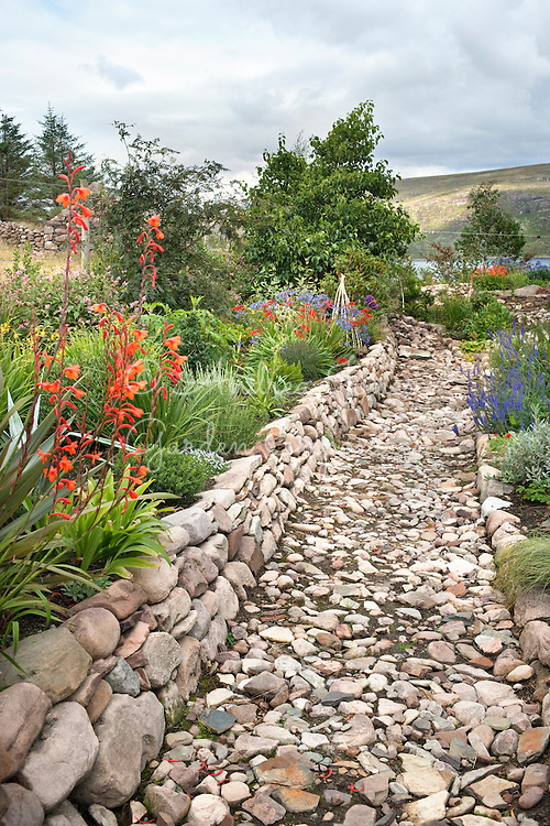 Cobbled path, stone wall and raised beds<br /> <br /> 2 Durnamuck, Little Loch Broom, Wester Ross, Scotland