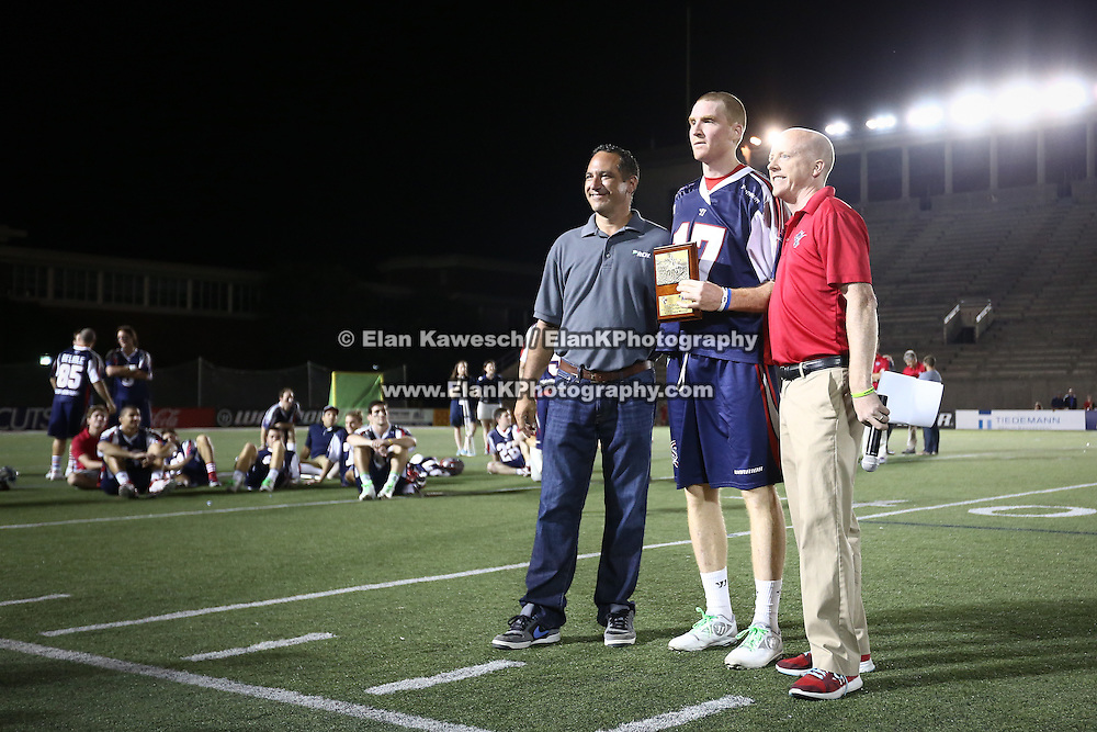 Brodie Merrill #17 of the Boston Cannons receives an award following the game at Harvard Stadium on August 9, 2014 in Boston, Massachusetts. (Photo by Elan Kawesch)